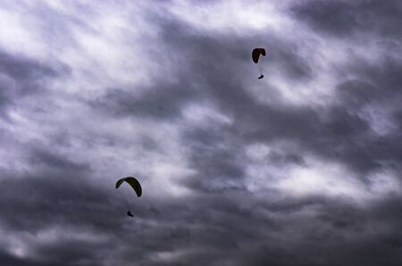 Paraglider on a background of cloudy sky Stock Photo
