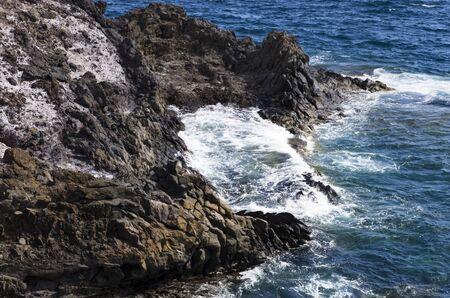 Coastal cliffs in the sea surf, landscape