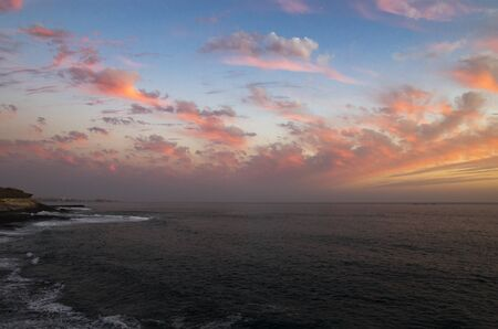 Colorful sunset on the coast of the Canary Islands, landscape Archivio Fotografico - 136890388