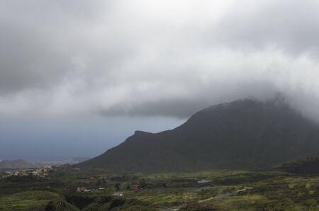 Mountain landscape in the clouds on the coast of the sea Archivio Fotografico