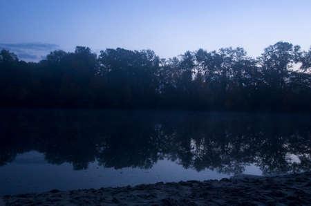 Autumn dawn over a quiet river
