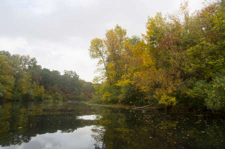 Landscape of a quiet river in autumn weather