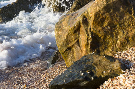 Sea waves run into coastal stones