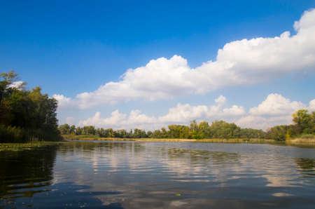 Landscape of an autumn river with vegetation along the banks Archivio Fotografico