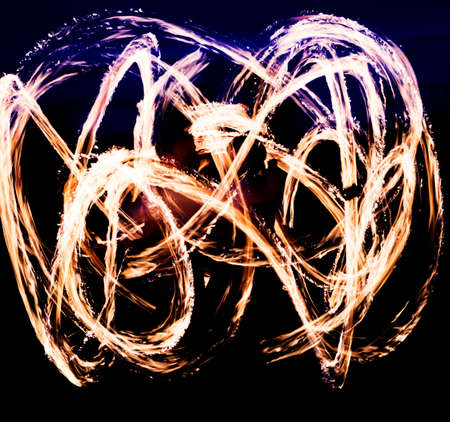 Lights from a fire show in the dark sky, background