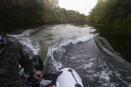 Ride on an inflatable boat on the autumn river