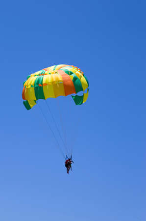 Parasailing in the blue sky