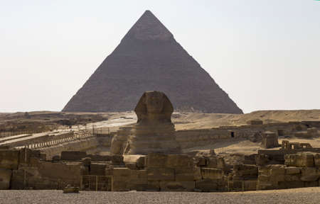 Sphinx on the background of the pyramid, landscape of Giza