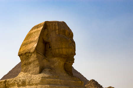 Sphinx head against the sky, giza