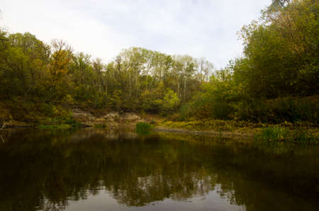 Autumn landscape of the river with trees on the bank Archivio Fotografico