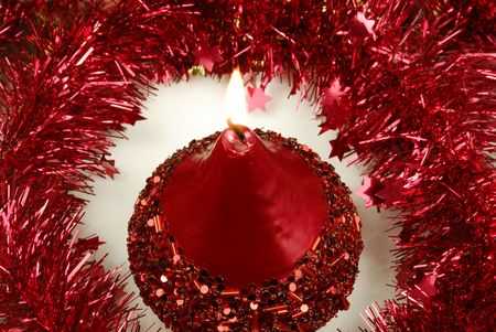 christmas candle and tinsel Stock Photo - 5995409