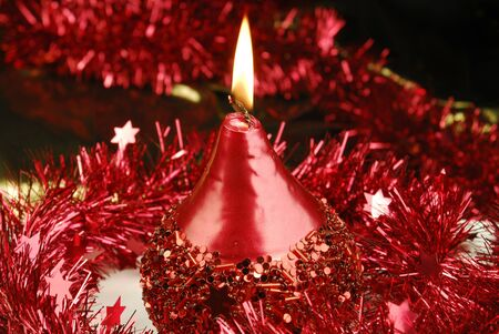 christmas candle and tinsel Stock Photo - 5995404