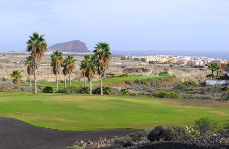 golf course with ocean and island view photo