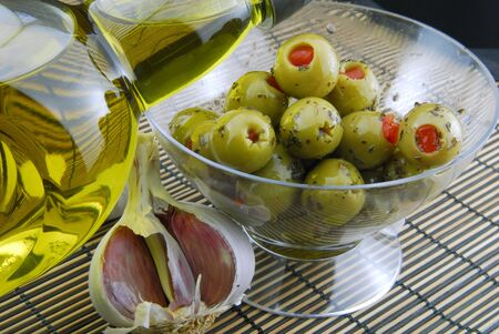 green olives stuffed with pimento ,spiced with basil and olive oil photo