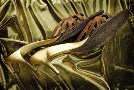 golden womans shoes on golden fabric  photo