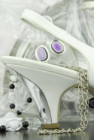 white bridal shoe with accessories photo