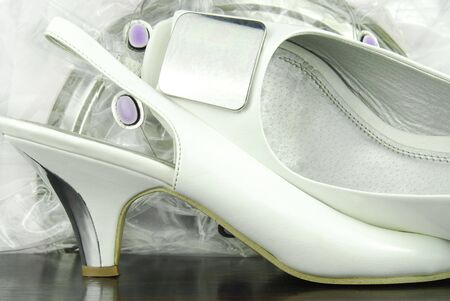 white and silver womans  shoes photo