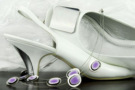 neckless: white bridal shoes with neckless Stock Photo