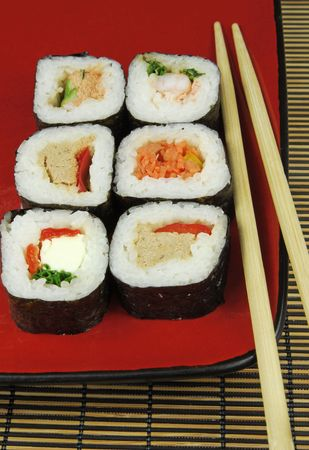 sushi futomaki  with chopsticks on red plate Stock Photo - 6770157