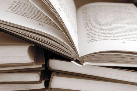 books in black and white sepia color photo