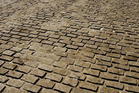 cobblestone pavement in sepia photo