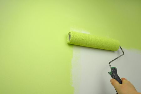 hand painting wall with roll in green color photo
