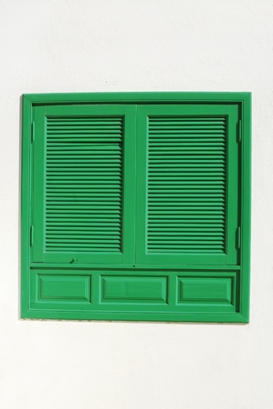 window coverings: green window with shutter Stock Photo