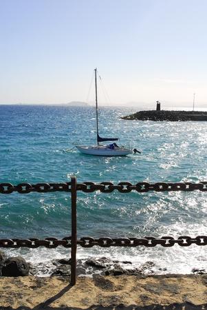 yacht in blue ocean in Lanzarote island,Canary islands,Spain photo