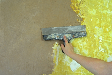 plaster filling wall repair photo