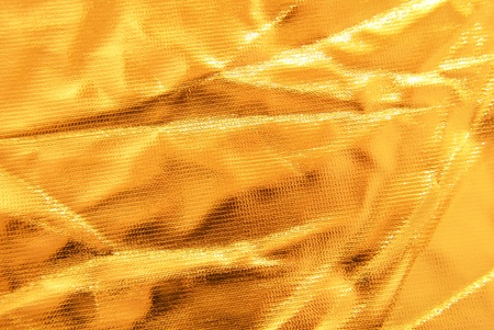 golden crumpled  fabric texture photo