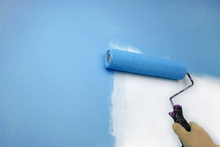 painting and decorating: hand painting wall Stock Photo
