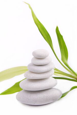 Zen stones isolated on white background with bamboo photo