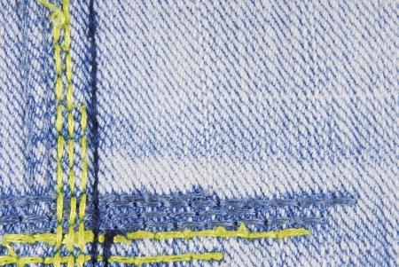 sew tags: Blue denim jeans seam border texture Stock Photo