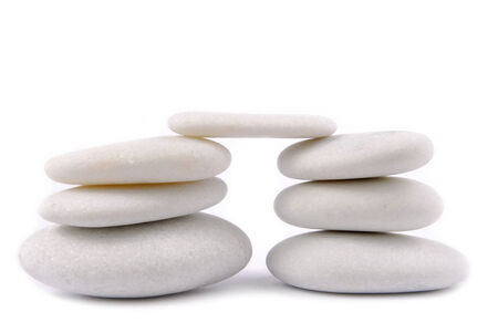 white stone pebble zen isolated on white photo