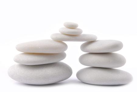 white stone pebble zen isolated on white photo