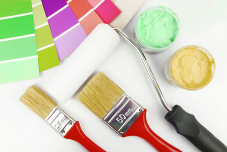 redecorate: paint brush and paint color choice for interior Stock Photo