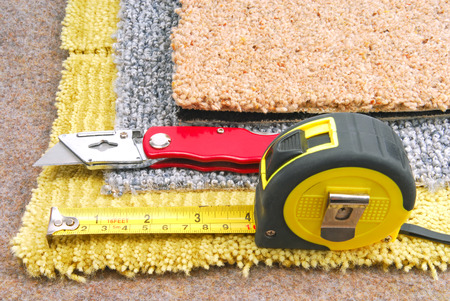 carpeting: carpet fitting with tools Stock Photo