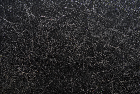 threadlike: black textured paper background