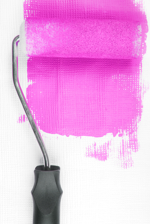 paint roller decorating wall photo