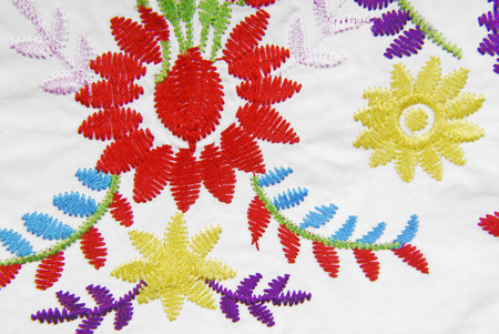 sewn up: embroidered fabric texture in old style Stock Photo
