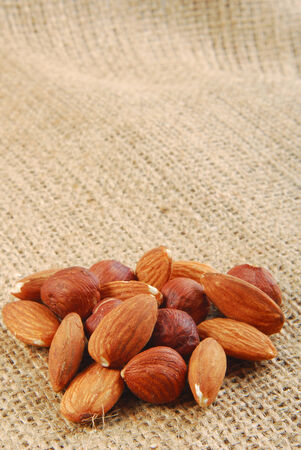 various nuts on hessian fabric photo