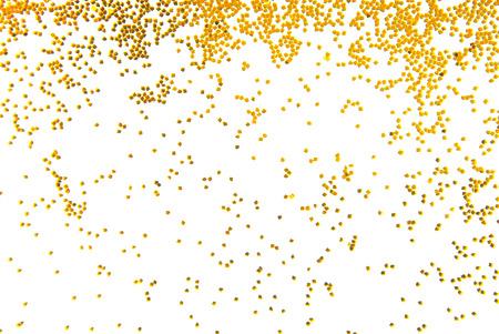 golden glitter falling isolated on white 写真素材