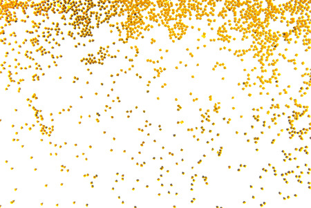 gold colour: golden glitter falling isolated on white Stock Photo