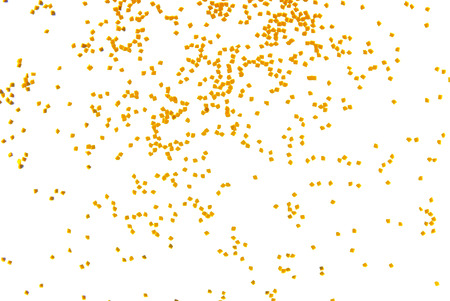 golden glitter falling isolated on white photo