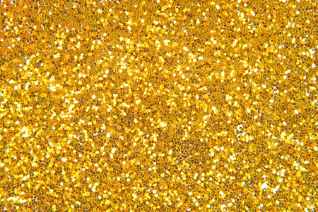 glittering: golden glitter background
