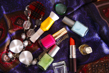 close up of the nail polish and accessory on silky scarf photo