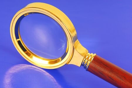 magnifying glass on blue background photo