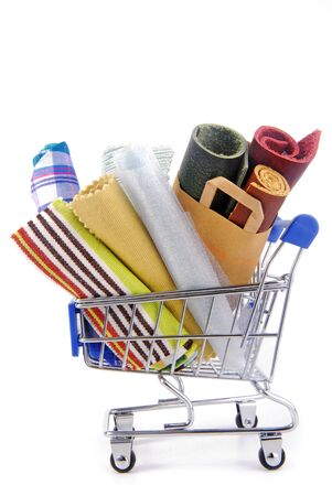 shopping trolley with various fabric materials photo