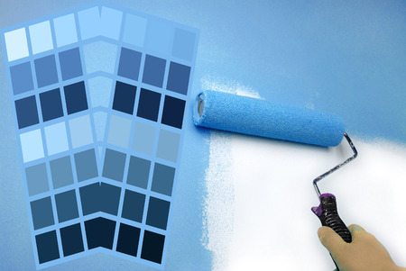 complimentary: complimentary blue color chart and hand painting wall Stock Photo