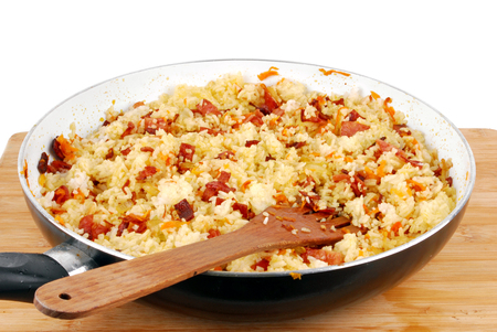 grits: pan of rice with ham carrots and onion
